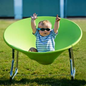 Cool dude. Young boy in green 'Flop' chair