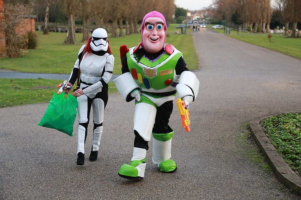 PR and Press photographer co-op funeral care Superhero funeral Buzz Lightyear and Stormtrooper image