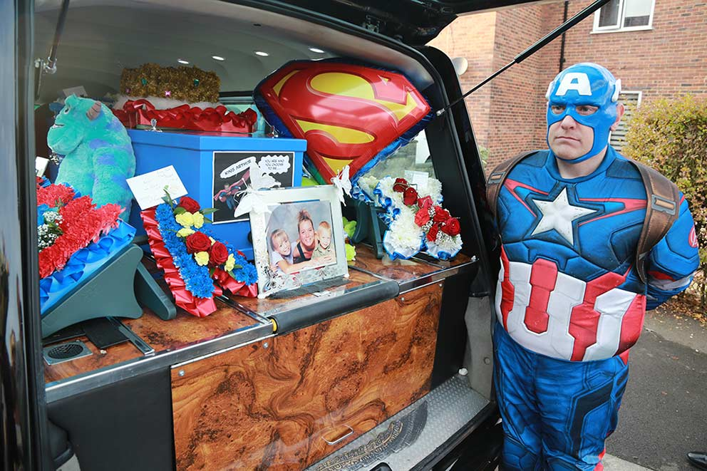 PR and Press photographer co-op funeral care Superhero funeral hearse image