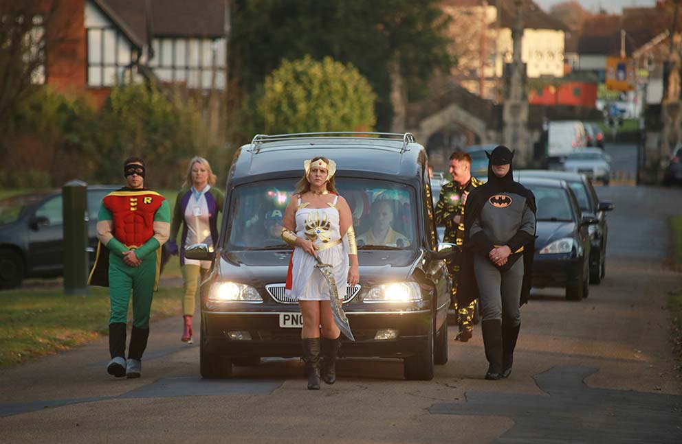 PR and Press photographer co-op funeral care Superhero funeral cortege image