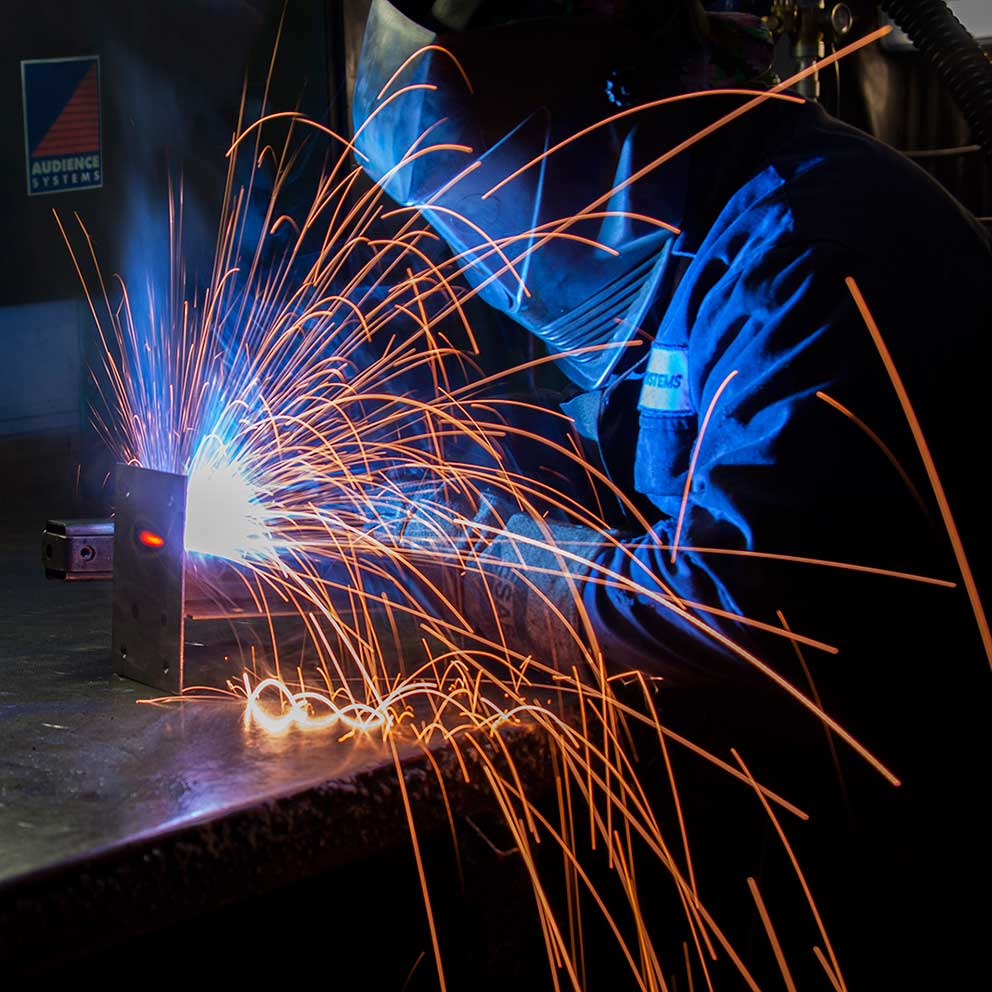Industrial manufacturing photography GMAW welding sparks light trails image