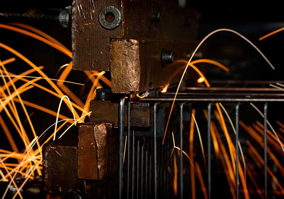 Manufacturing industrial photography factory welding steel wire baskets sparks image