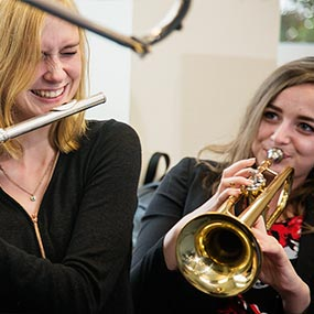 Educational Photography - Playing trumpet and flute in Sixth Form music room image
